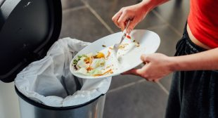 Put These 3 Things Next To Your Trash Can To Keep Smells To A Minimum